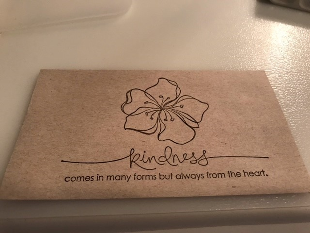 """Envelope stamp that reads """"kindness comes in many forms but always from the heart""""."""