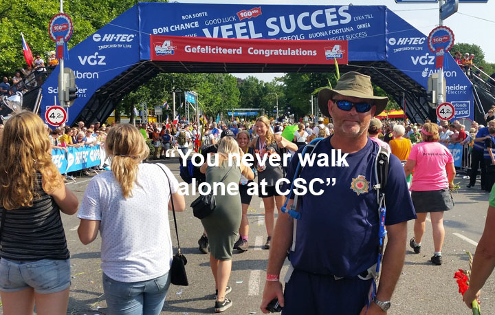 """A photo of Doug Holsworth with the text """"You never walk alone at CSC"""""""