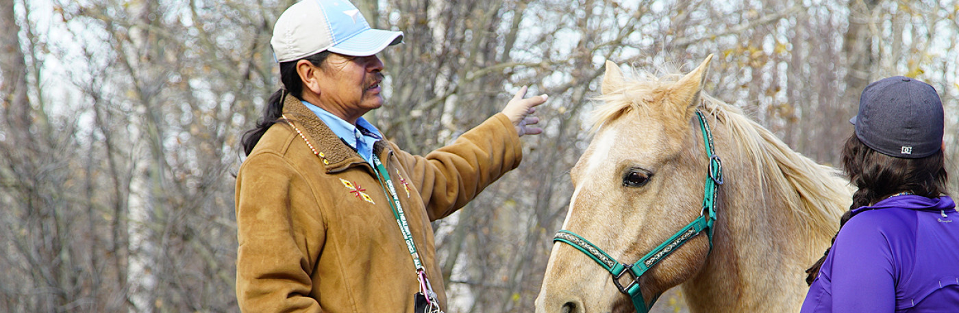 A photo of Dale Mosquito with a horse and an offender