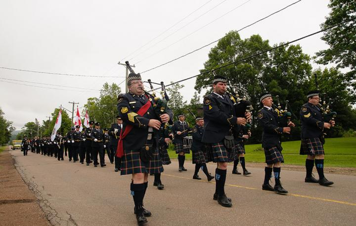 A photo of CSC's pipes and drums unit marching in a parade through Dorchester Village.